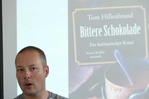 """Tom Hillenbrand stellt seinen im Herbst erscheinenden Krimi """"Bittere Schokolade"""""""